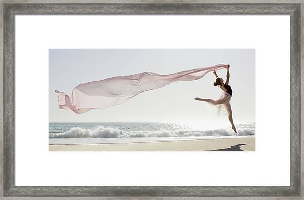 Dancer Leaping On Beach Framed Print