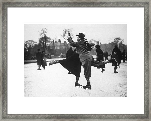 Dancing On Ice Framed Print by H. F. Davis