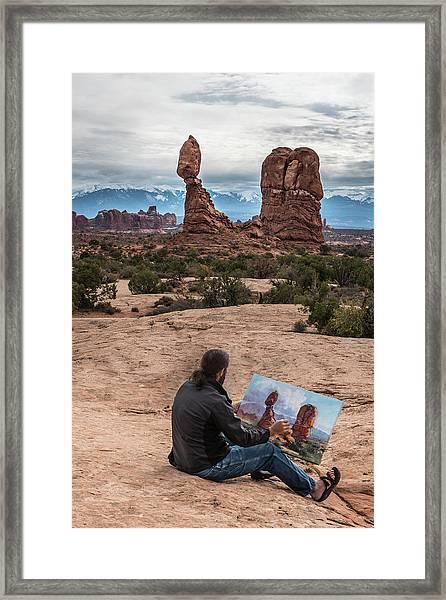 Daniel Paints Balanced Rock Framed Print