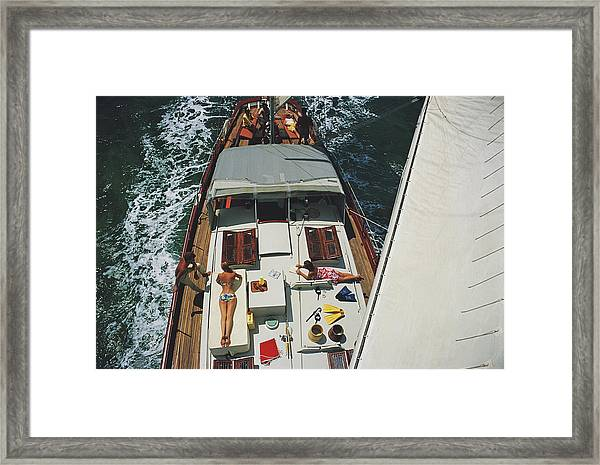Deck Dwellers Framed Print by Slim Aarons