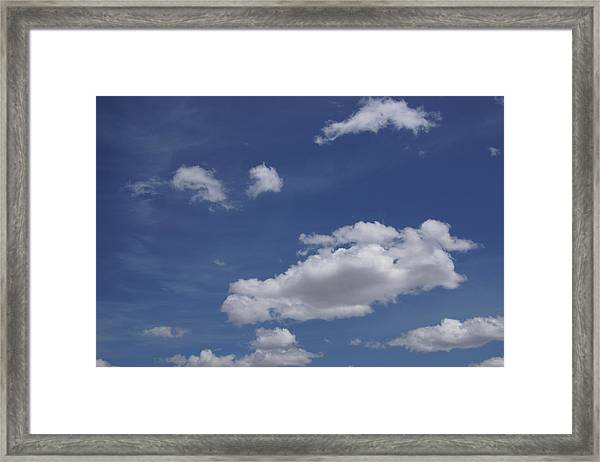Deep Blue Sky And Fluffy Cumulous Cloud Framed Print