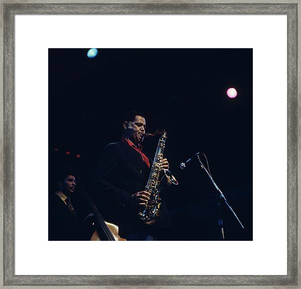 Dexter Gordon Performs On Stage Framed Print by David Redfern
