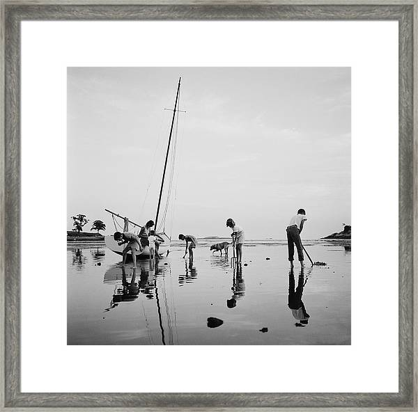 Digging For Clams Framed Print by Slim Aarons