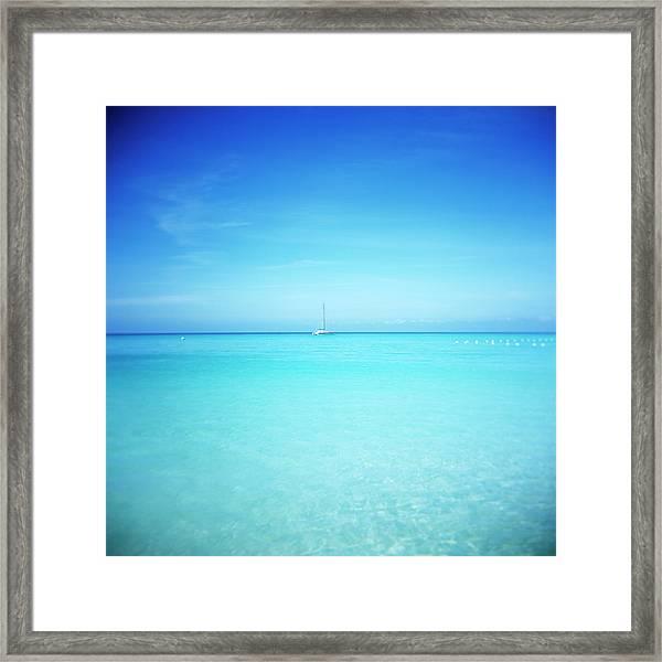Distant Boat In The Caribbean Ocean Framed Print