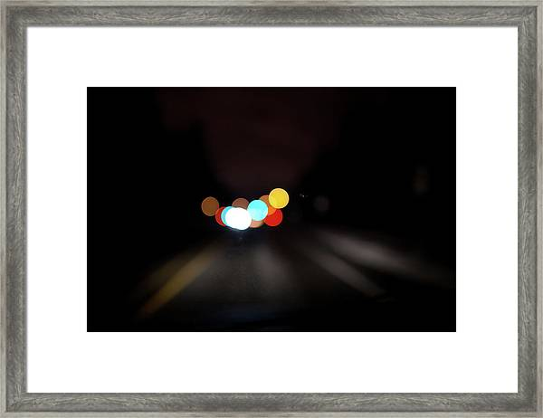 Driving At Night With Colourful Lights Framed Print