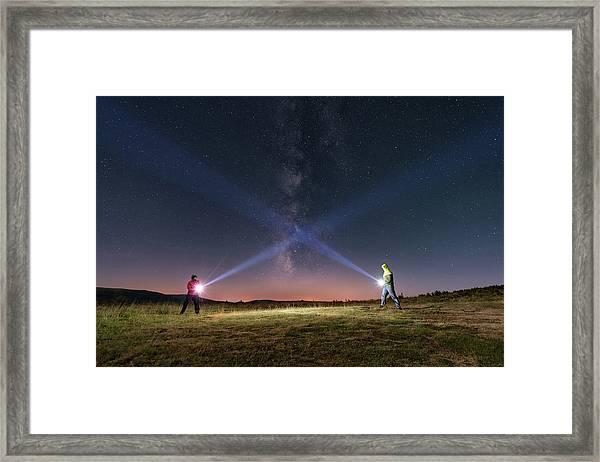 Duel Of Light Framed Print