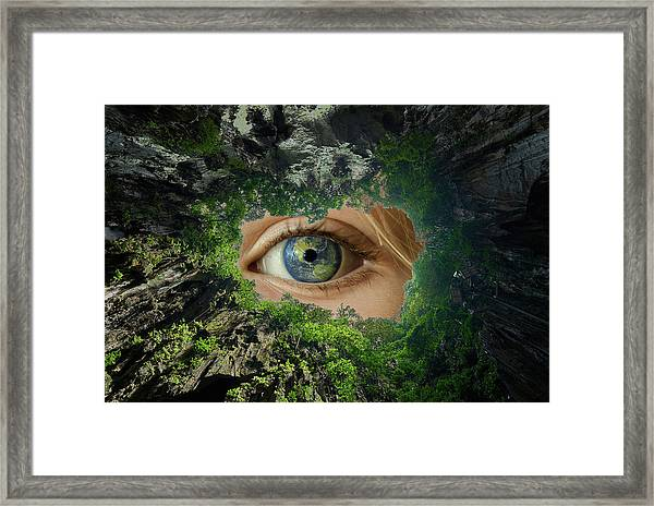 Earth Is Watching You Framed Print