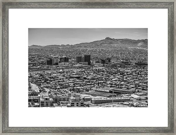 Framed Print featuring the photograph El Paso, Texas And Ciudad Juarez Skyline Black And White by Chance Kafka