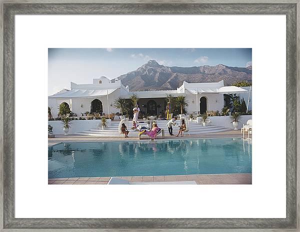 El Venero Framed Print by Slim Aarons