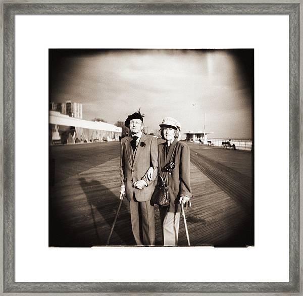 Elderly Couple On Boardwalk, Portrait Framed Print
