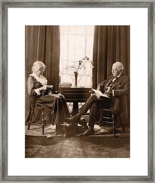 Elderly Couple Relaxing At Home Framed Print by Fpg