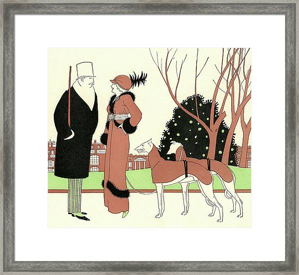 Elegant Couple With Two Dogs Framed Print