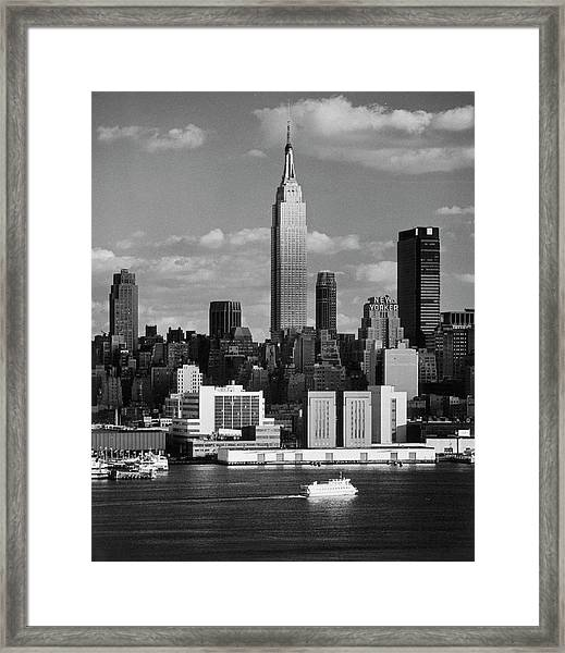 Empire State Building And Skyline Along Framed Print