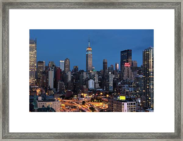 Empire State Building In Subway Series Framed Print
