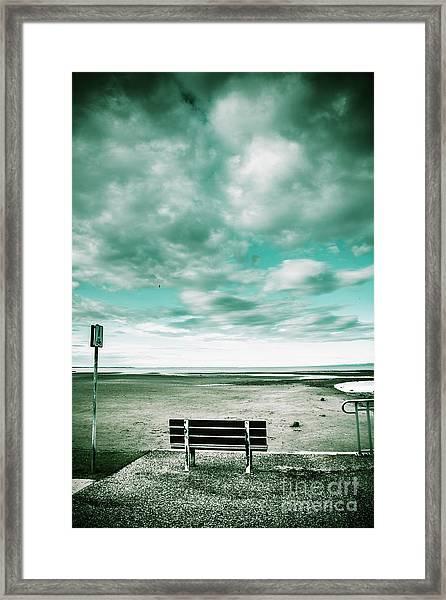 Empty Beach Bench Framed Print