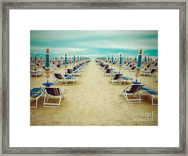 Empty Beach Scenery With Deckchairs And Framed Print by Anastazzo