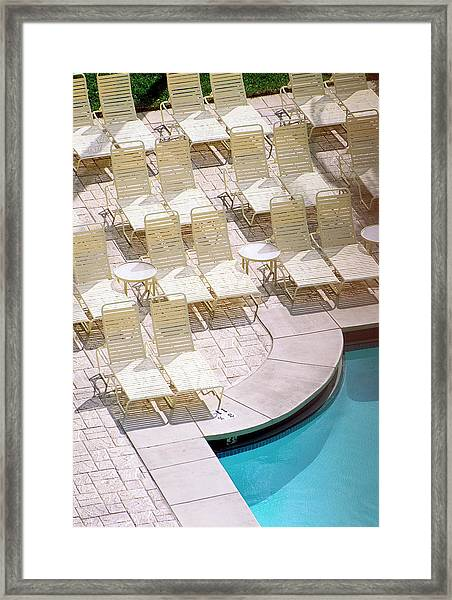 Empty Poolside Chairs At A Holiday Framed Print by Wesley Hitt