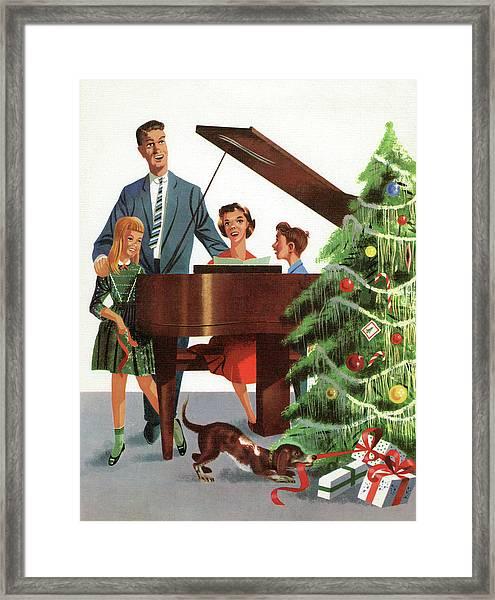 Family Singing Christmas Carol Framed Print