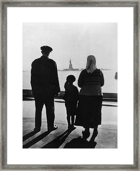 Family Views Statue Of Liberty From Framed Print