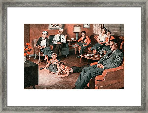 Family Watching Television Framed Print