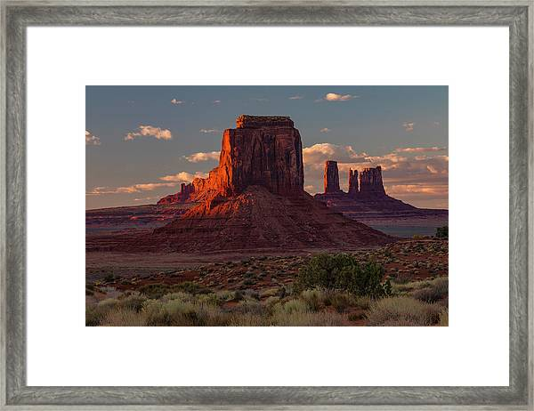 Famous Buttes Of Monument Valley Framed Print by Adam Jones