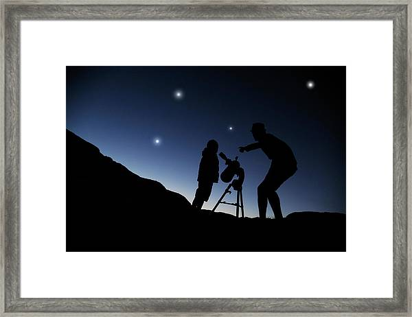 Father And Son Looking Through A Framed Print by Chris Stein