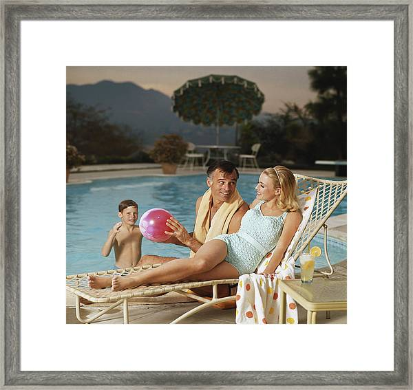 Father And Son Playing With Beach Ball Framed Print