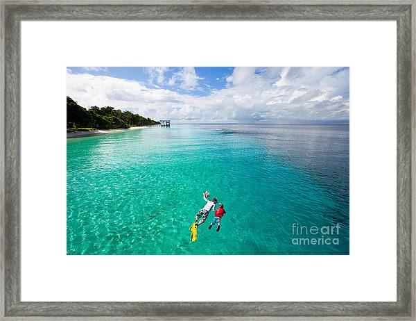Father And Son Snorkeling In A Tropical Framed Print