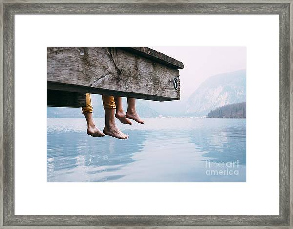 Father And Son Swung Their Legs From Framed Print