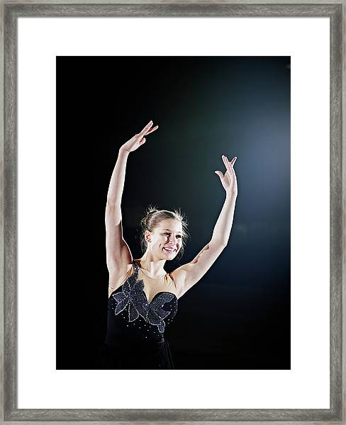 Female Figure Skater Posing With Arms Framed Print by Thomas Barwick