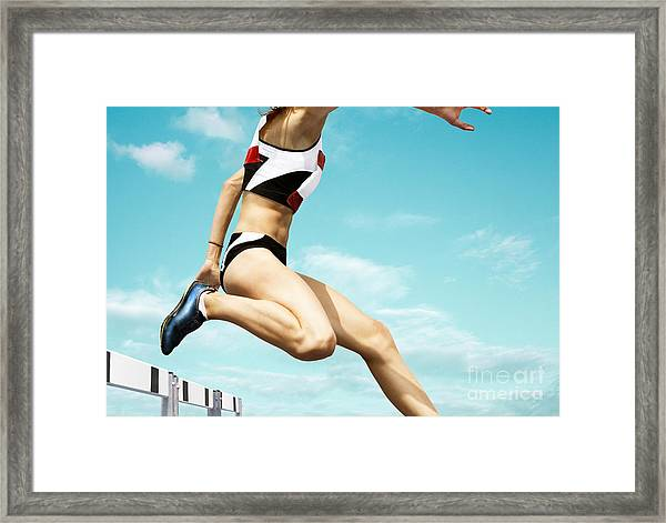 Female Hurdle Runner Leaping Over The Framed Print