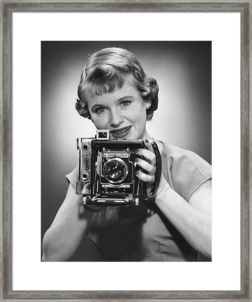 Female Photographer Framed Print