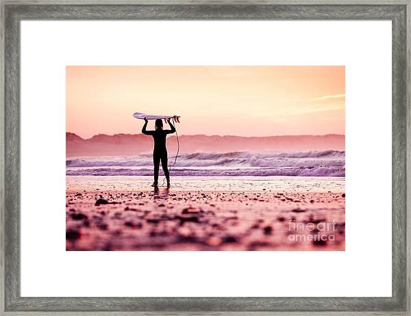 Female Surfer On The Beach At The Sunset Framed Print