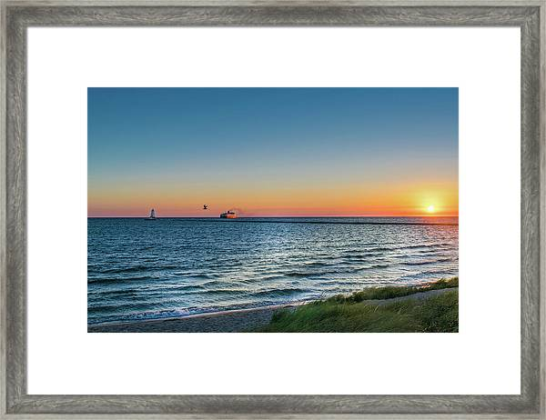 Ferry Going Into Sunset Framed Print