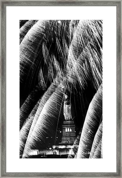 Fireworks Explode Around Statue Of Framed Print