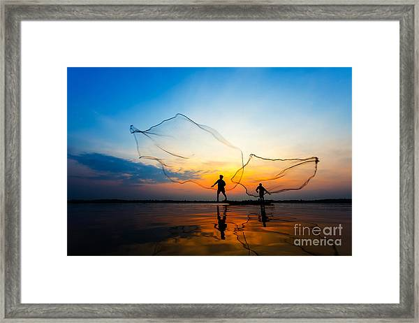 Fishermans In Action When Fishing At Framed Print