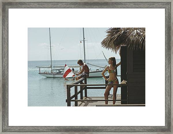 Fishing On Honeymoon Porch Framed Print by Slim Aarons
