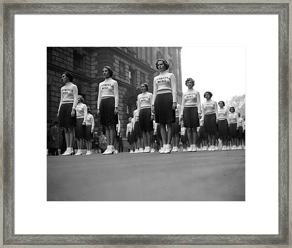 Fitness Wins Framed Print by London Express