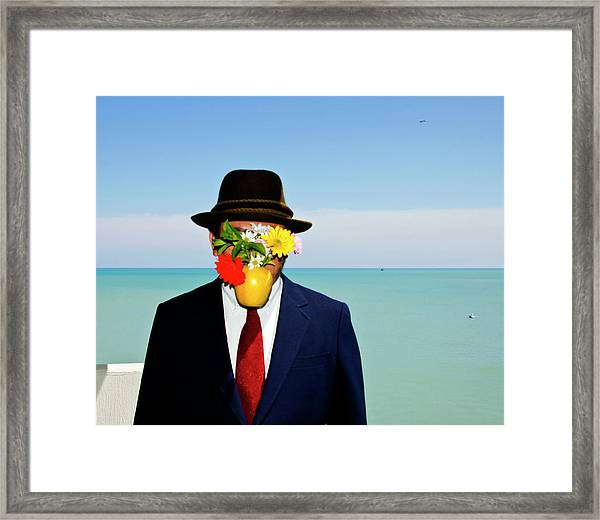 Flower On Face Framed Print by By Ken Ilio