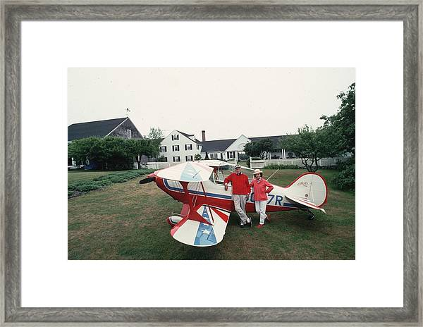 Flying Beetle Framed Print by Slim Aarons