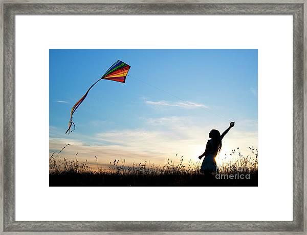 Flying Her Kite Framed Print