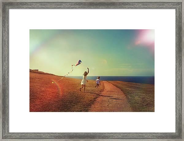 Flying The Kite Framed Print