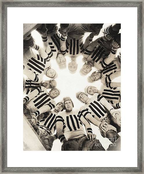 Football Huddle Framed Print
