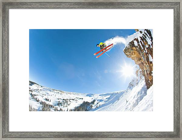 Freestyle Skier Jumping Off Cliff Framed Print