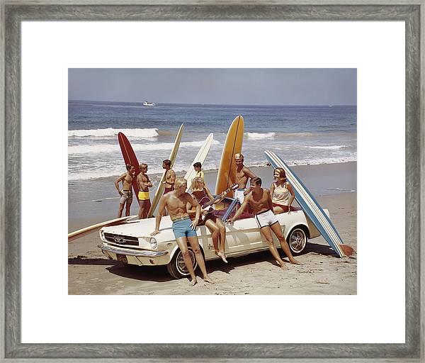 Friends Having Fun On Beach Framed Print by Tom Kelley Archive