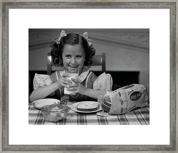 Girl Drinking A Glass Of Milk Framed Print by George Marks