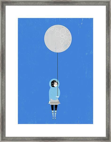 Girl Holding Full Moon Balloon Framed Print