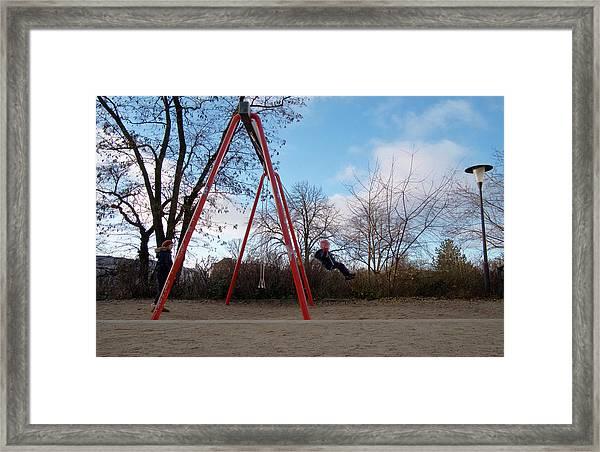 Girl On Swing Framed Print