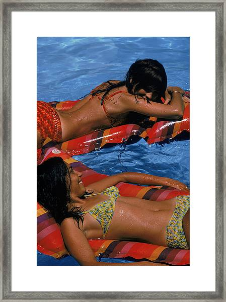 Girls On Lilos Framed Print by Slim Aarons