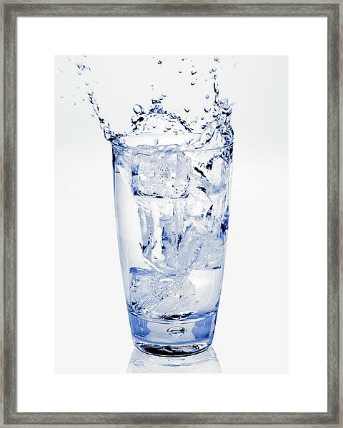 Glass Of Water Splashing Around Framed Print by Maria Toutoudaki